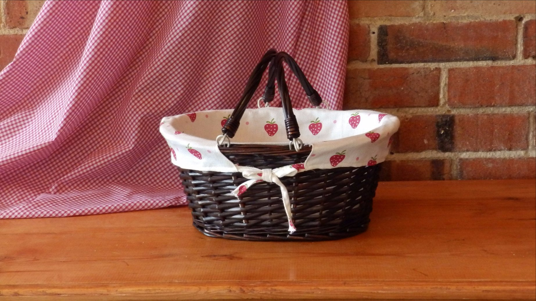 Oval Wicker Basket with Handles and Strawberry Print Lining